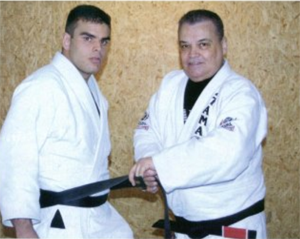 Carlson Gracie presenting Christian Grandi with his Black Belt in Jiu Jitsu